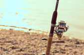 Fishing rod, and reel — Stock Photo