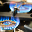 Gas stove with blue flames — Stock Photo