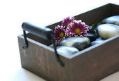 Wooden box with Hot Stones for wellness and massage — Stock Photo