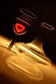 Wine glass with red wine and decanter — Stock Photo