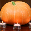 Pumpkin in light of candles — Stock Photo #22313419