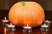 Pumpkin in light of candles — Stock Photo