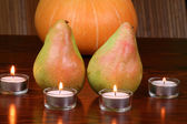 Pears and tealights — Stock Photo