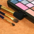Cosmetic brushes and eye shadows — Stock Photo