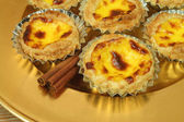 Pasteis de nata - egg tarts on golden plate — Stock Photo