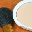 Powder with brush — Stock Photo