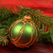 Green glass ball in Christmas wreath — Stock Photo #25620627