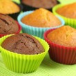 Muffins in colorful moulds - Stock Photo