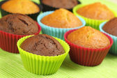 Muffins in colorful moulds — Stock Photo