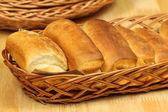 Breakfast buns in basket — Stock Photo