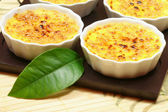 Creme brulee with leaf — Stock Photo