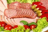 Ham, sausage with garnish — Stock Photo