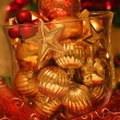 Glass vase with Christmas balls — Stock Photo