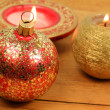 Christmas ball and candles — Stock Photo