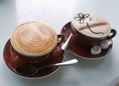 Cappuccino and chocolate — Stock Photo