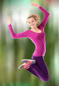 Fitness woman jumping excited — Stok fotoğraf