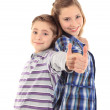 Two happy young kids with thumbs up — Stock Photo