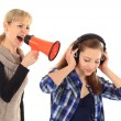 Young woman screaming at her daughter with a megaphone on white — Stock Photo