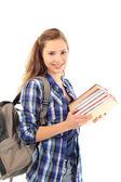 Joven estudiante con un montón de libros aislados en blanco — Foto de Stock