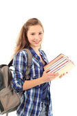 Young female student with bunch of books isolated on white — Stok fotoğraf
