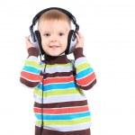 Child in headphones, white background — Stock Photo #21213585