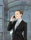 Portrait picture of a business woman talking on the phone on whi — 图库照片