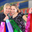 Two beautiful woman with a shopping bags. — Стоковая фотография