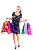 Beautiful woman with a shopping bags. Isolated on white. — Zdjęcie stockowe