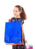 Alışveriş torbaları ile güzel bir kadın. beyaz izole. — Stok fotoğraf