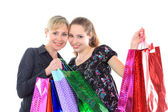 Two beautiful woman with a shopping bags. Isolated on white. — Stok fotoğraf