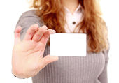 Girl in a business card - isolated over a white background — Stock Photo