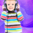 Child in headphones, color background — Stockfoto