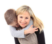 A young boy is whispering a secret in his mothers ear — Foto de Stock