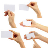 Hands hold business cards collage on white background — Zdjęcie stockowe