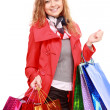 Stock Photo: Beautiful womwith shopping bags. Isolated on white.