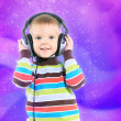 Stock Photo: Child in headphones, color background