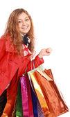 Schöne frau mit einem einkaufstüten. isoliert auf weiss. — Stockfoto