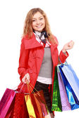 Mooie vrouw met een boodschappentassen. geïsoleerd op wit. — Stockfoto