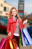 Happy woman with a shopping bags. — Stock Photo