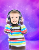 Child in headphones, color background — Stock Photo