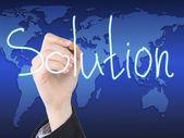 Kvinnor hand skriva lösning — Stockfoto