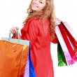Beautiful woman with a shopping bags. Isolated on white. — Stock Photo #22497777