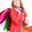 Beautiful woman with a shopping bags. Isolated on white. — Стоковая фотография