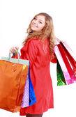 Mujer hermosa con un bolsas de compras. aislado en blanco. — Foto de Stock