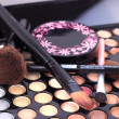 Stock Photo: Makeup brushes and make-up eye shadows