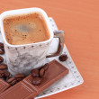 ストック写真: Cup of coffee with chocolate on table