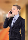 Portrait picture of a business woman talking on the phone — Stock Photo