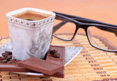 Cup of coffee with chocolate and glasses — Stock Photo