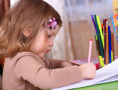 Beautiful little girl drawing with pencils — Stock Photo