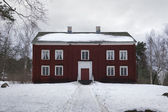 Big wooden red house and snow — Stok fotoğraf